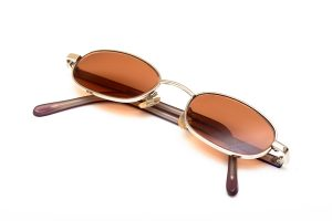 A pair of prescription sunglasses isolated on a white background