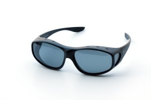 Close up of wrap around black sunglasses isolated over white